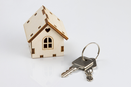 The Wooden House And Key. On a white background 版權商用圖片