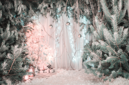 light Christmas decorations. A beautiful New Year tree with balls and gift boxes.Photo in the studio, New Year decoration, fairy forest, 2018.