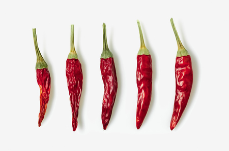 Dried red chili or chilli cayenne pepper isolated on white background cutout Stock Photo