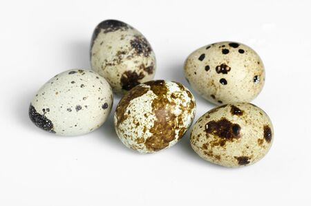 Quail eggs are isolated on a white background. Stock Photo
