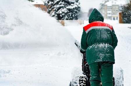 Man Removing Snow with a Snow Blower.