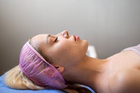 Young woman visiting cosmetologistUltrasonic Skin Cleansing Procedure. Beauty Treatment. Cosmetology. Beauty Spa Salon