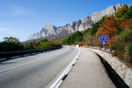 highway among the mountains and blue sky photo