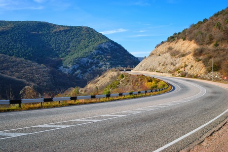 highway among the mountains and blue sky Stock Photo - 11791862