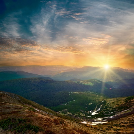 fantasy landscape: majestic mountain sunset and colored sky with clouds Stock Photo
