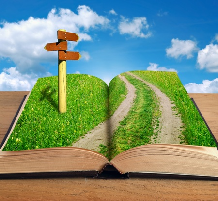 signpost: magic book with road inside and signpost on sky background Stock Photo