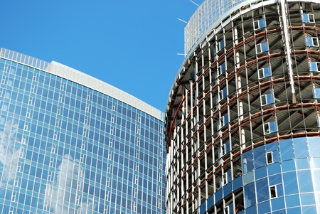 building of new office center on blue sky background