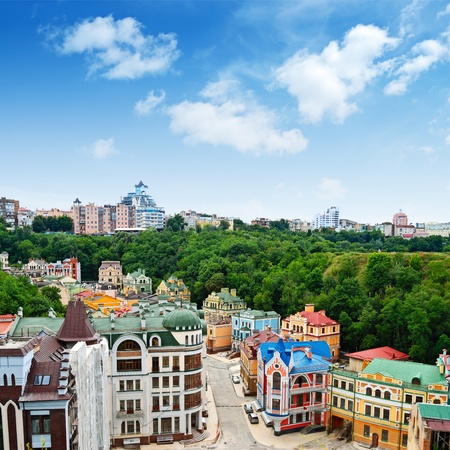 Multicolored houses among the green trees and blue sky. Panoramic view from the hill. Placed in Kiev, Ukraine almost in center of city. photo