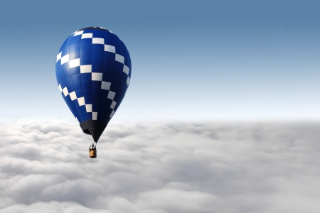 hot air balloon flying over the clouds