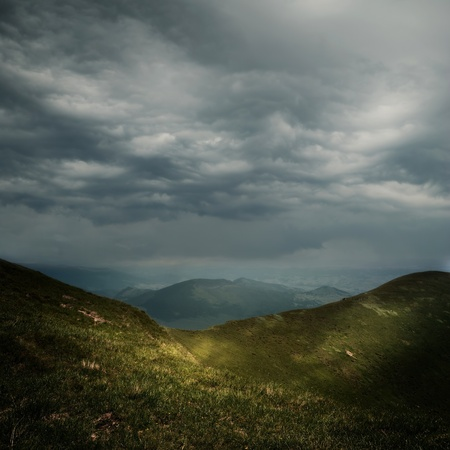 dark clouds: storm clouds over the mountains Stock Photo