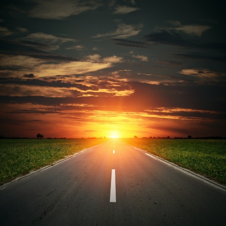 asphalt road to horizon with sunset sky