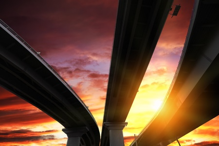 Overpass silhouette on sunset sky background