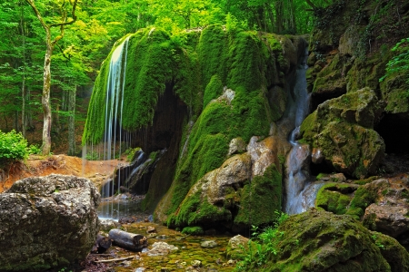 waterfall  Silver streams  in Crimea green forest with wet mossy stones Stock Photo