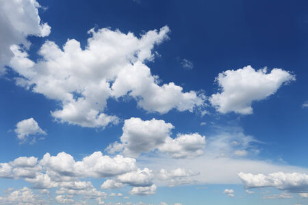 fluffy white clouds on blue sky in sunny summer day Stock Photo - 25170970