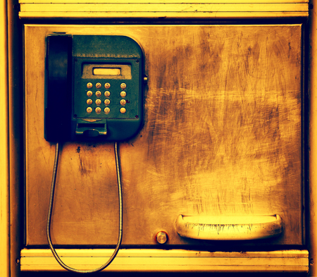 old telephone on grunge metal wall with scratches Stock Photo - 25171017