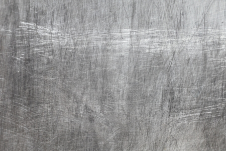 metal texture with scratched abstract pattern closeup photo