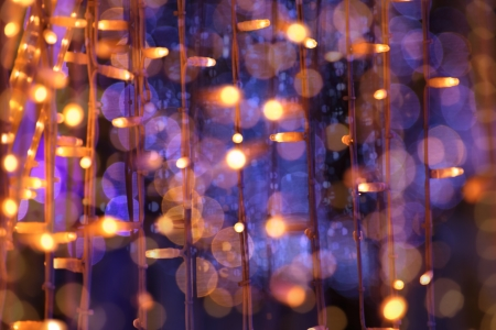 festoon: christmas festoon blurred lights background with orange and violet colors