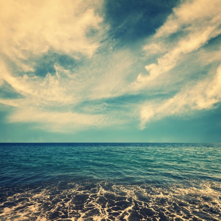 sea water and beautiful clouds on sky with retro colors  Stock Photo