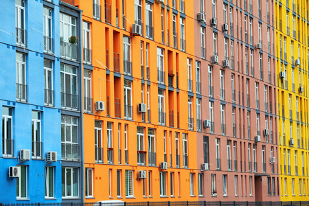 Colorful buildings and windows with air conditioners photo