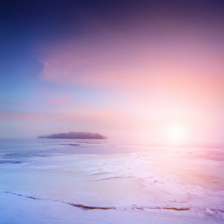 frozen river: winter landscape, sunrise over frozen river with a beautiful clouds on sky
