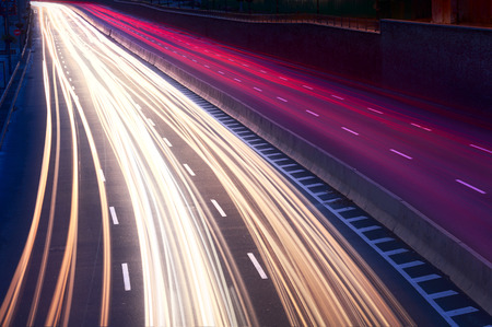 speed car: Car light trails on the city street at night. Long exposure photo Stock Photo