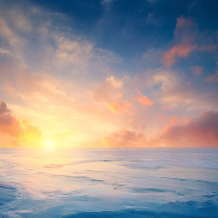 endlessness: Winter landscape. Frozen sea and fantastic sunset sky. Sunlight reflected on the ice