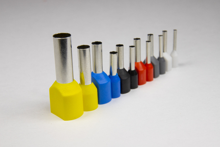 Multicolored metal-plastic tips for crimped electrical wires