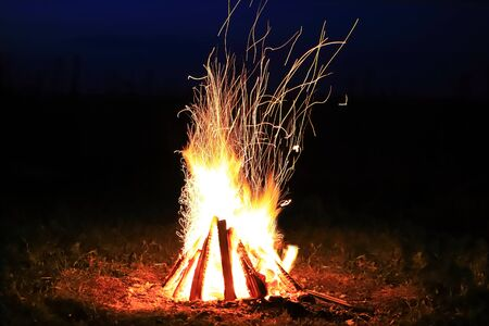 Bonfire with sparks and strong fire at night in total darkness Reklamní fotografie