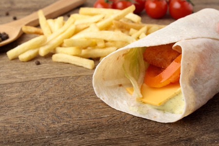 epicure: Grilled fish with tomato and onion in pita bread