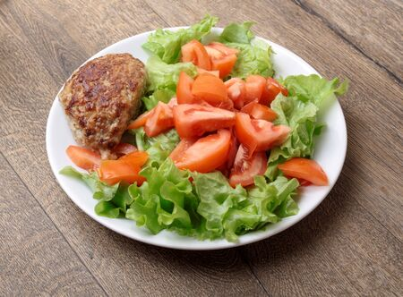 rubicund: Fried meatballs with salad Stock Photo