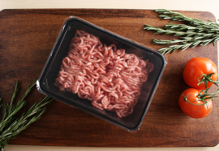 minced meat in packing on a wooden background 스톡 콘텐츠 - 104871653
