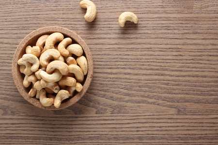cashew nuts on wooden background Stock Photo