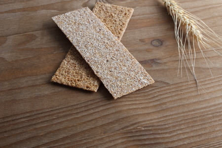 rye cpispbread on a wooden background Stock Photo