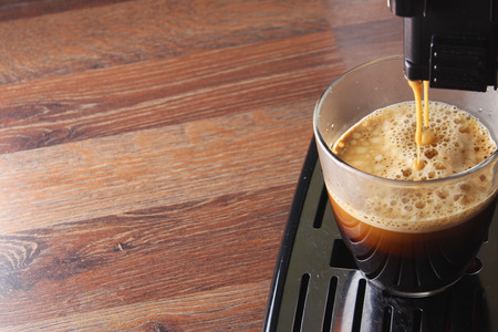 coffee glass espresso coffee machine wooden background