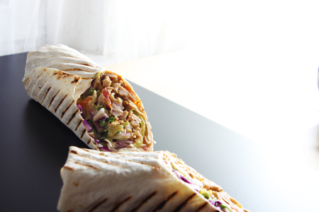 shawarma kebab on a black background