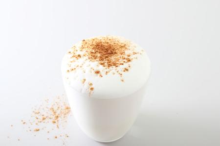 milk foam cinnamon glass on a light background