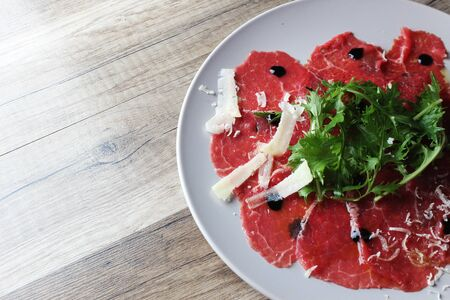 carpaccio on a wooden background Stock fotó