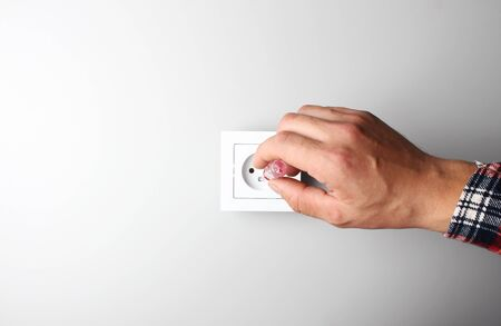 hand repair socket on gray background