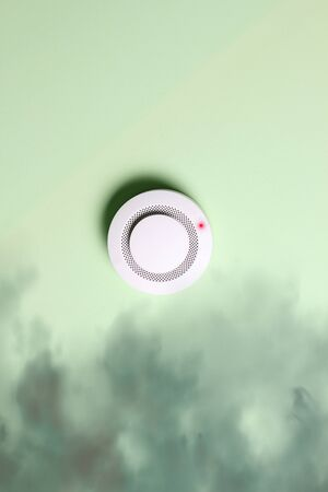 fire alarm sensor on a green light background 版權商用圖片