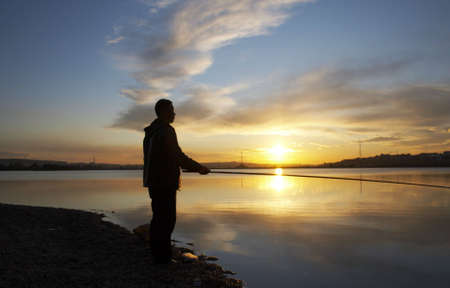 fishingline: man with fishing rod on the sunset