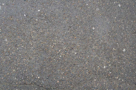 texture of old wet asphalt (blacktop). There is metal fraction and water visible. photo