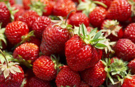 big heap of strawberry. Volume of heap is visible. photo