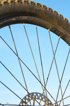 spoke: part of bike wheel with tyre, rim, spoke and disk brake Stock Photo