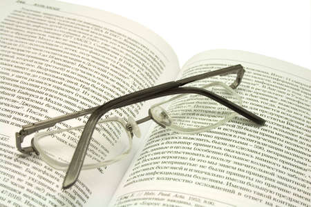 cyrillic: glasses lying on the open book