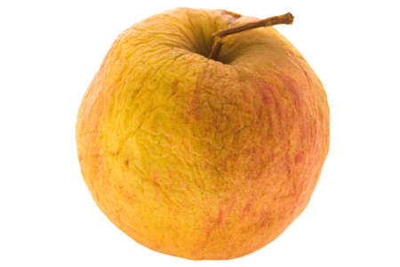 withering: isolated withering apple Stock Photo