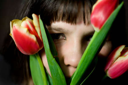 middle-aged woman with tulips.   expression photo