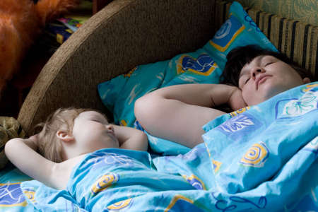 photo of sleeping child and his mother photo