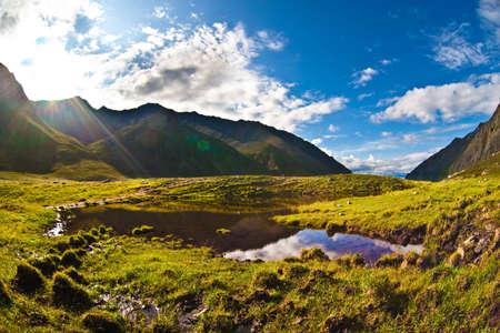Morning at mountain lake. Very sunny, beautiful weather Stock Photo - 5433062