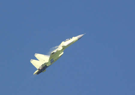 steam jet: Photo of Su-30 making aerobatics. There is water condensate visible above wings. Stock Photo