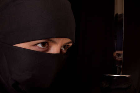 sabotage: Photo of woman in shinobi suit with wakizashi on black background